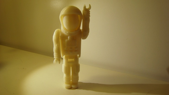 a white plastic astronaut figure